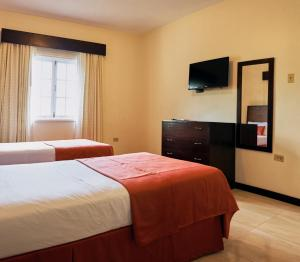 A bed or beds in a room at Shirley Retreat