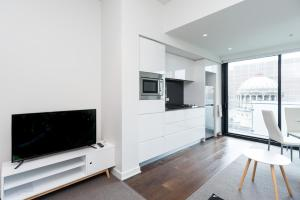 A television and/or entertainment center at Relax in Luxury & Modern MELB 1BD