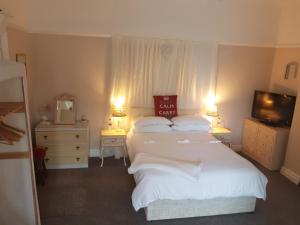 A bed or beds in a room at The Gateway at Hest Bank