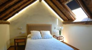A bed or beds in a room at El Jardín del Convento