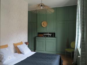 Un ou plusieurs lits dans un hébergement de l'établissement Le Jardin De Gustave