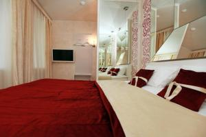 Кровать или кровати в номере Отель Делайт