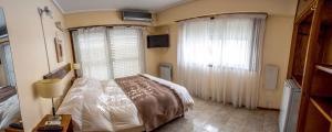 Una cama o camas en una habitación de Hi Patagonia Hostel