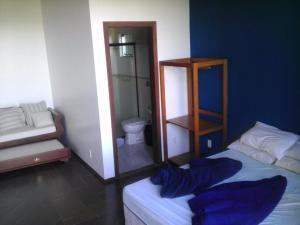 Cama o camas de una habitación en Quintal do Gravatá