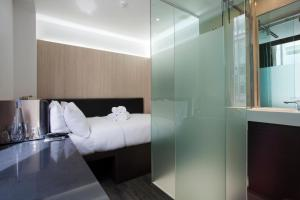 A bed or beds in a room at The Z Hotel Victoria