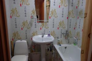 Ванная комната в Apartment on Voskresenskaya 9