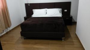 Cama o camas de una habitación en Hotel Victoria Real