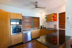 A kitchen or kitchenette at Casuarina Cove 13