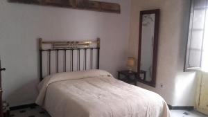 A bed or beds in a room at Casa Cossio