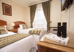 Cama o camas de una habitación en Hotel Carpa Manzano