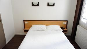 Cama o camas de una habitación en Hôtel Liège Strasbourg