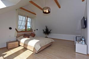 Ein Bett oder Betten in einem Zimmer der Unterkunft Prie Žiedo