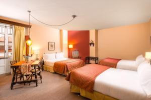 Cama o camas de una habitación en Hotel Dann Monasterio