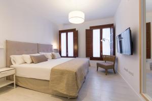 Cama o camas de una habitación en Shine Alcaiceria
