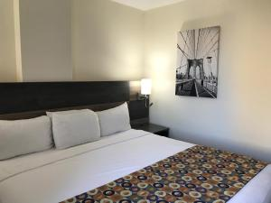 A bed or beds in a room at Bogart Hotel