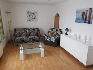 Ein Sitzbereich in der Unterkunft Hotel Domke Haus an der See