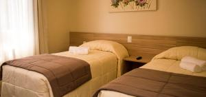 A bed or beds in a room at Sky Serra Hotel