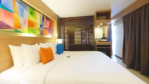 A bed or beds in a room at Altabriza Resort Boracay