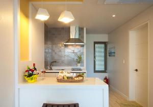 A kitchen or kitchenette at Comma&Spa Resort