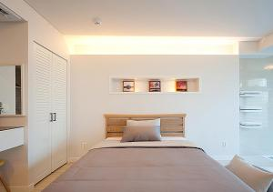A bed or beds in a room at Comma&Spa Resort