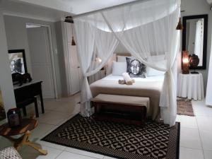 A bed or beds in a room at St Lucia Kingfisher Lodge