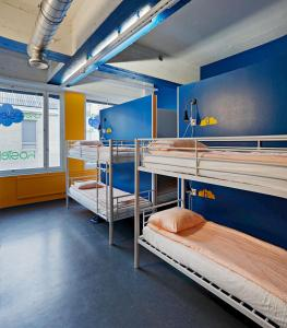 A bunk bed or bunk beds in a room at CheapSleep Hostel Helsinki