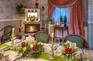 A restaurant or other place to eat at Landhotel Schwarzer Adler