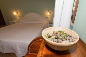 Ein Bett oder Betten in einem Zimmer der Unterkunft Country House Le Calvie