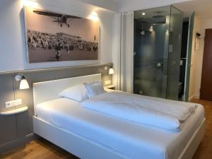 Ein Bett oder Betten in einem Zimmer der Unterkunft Der Kleine Hans