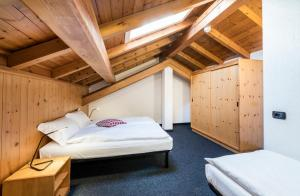 A bed or beds in a room at Residence Nevegall