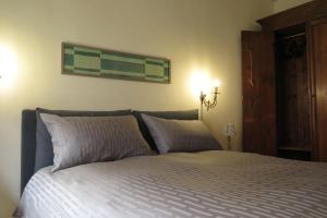 A bed or beds in a room at Signoria apartment