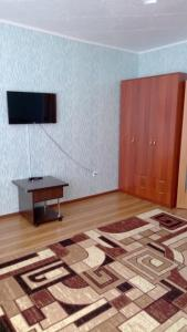 A television and/or entertainment center at Апартамент