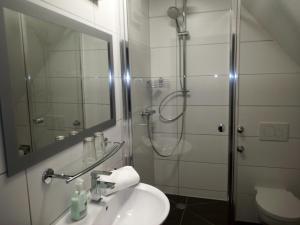 A bathroom at Hotel Brehm