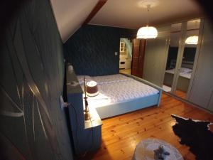 Łóżko lub łóżka w pokoju w obiekcie Apartament w Górach
