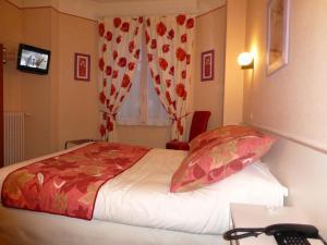 Un ou plusieurs lits dans un hébergement de l'établissement Trianon