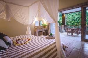 A bed or beds in a room at Wapa di Ume Ubud