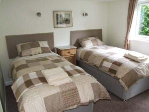 A bed or beds in a room at Ashes Lodge