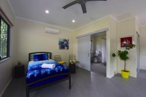 A bed or beds in a room at Daintree Peaks ECO Stays