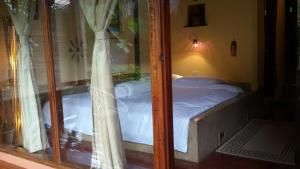 A bed or beds in a room at Mandala Ou Resort