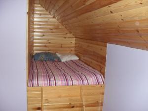 Łóżko lub łóżka w pokoju w obiekcie Pohulanka - Białowieża