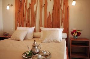 Cama ou camas em um quarto em Pousada Dona Flor