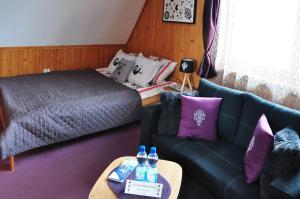 Łóżko lub łóżka w pokoju w obiekcie MSC Apartments Honeymoon 2
