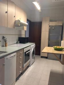 A kitchen or kitchenette at Casita bien equipada en buena zona!
