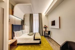 A bed or beds in a room at Trevi Collection Hotel - Gruppo Trevi Hotels
