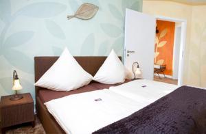 Ein Bett oder Betten in einem Zimmer der Unterkunft Villa Wunderbar