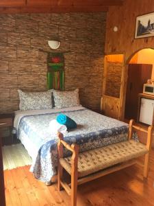 A bed or beds in a room at Departamentos El Yugo
