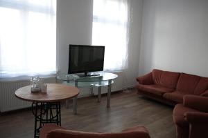 A seating area at Przestronny Apartament