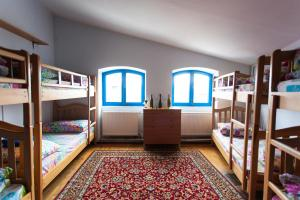 A bunk bed or bunk beds in a room at Namaste Hostel