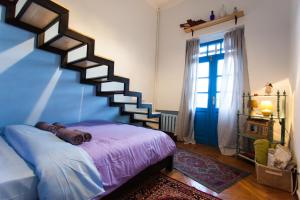 A bed or beds in a room at Namaste Hostel