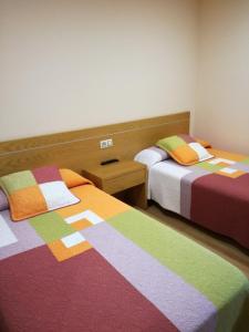 Cama o camas de una habitación en Hotel Restaurante Cazador